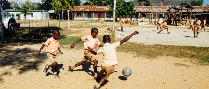 children-playing-soccer-2898317